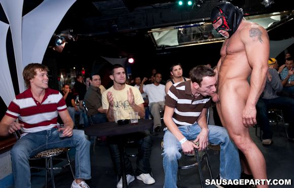 Gay stripper gets blowjobs from male audience
