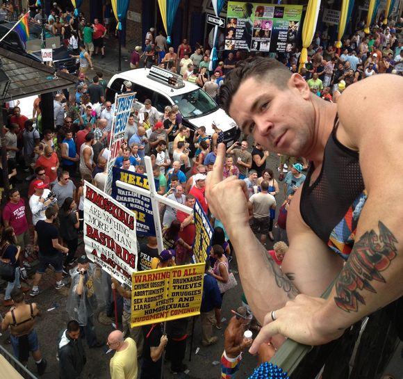 Trenton Ducati gay porn star flipping off the anti gay protestors